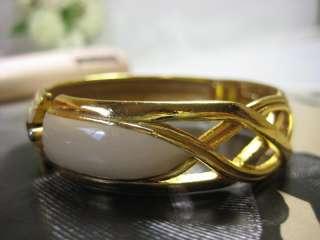 Vintage and beautiful Lanvin Paris cream Enamel and gold toned bangle