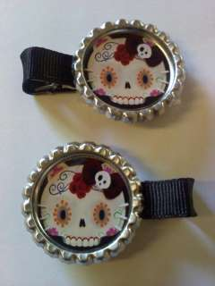 Two Hello Kitty day of the dead dia de los muertos bottle cap clips
