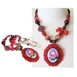 Tarina Tarantino Hello Kitty Pink Head Russian Nouveau Ribbon Necklace