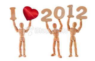 love 2012   wooden mannequins holding words Royalty Free Stock Photo