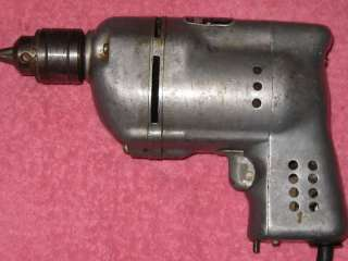Up for auction is a vintage Black & Decker model 100 1/4 drill. It