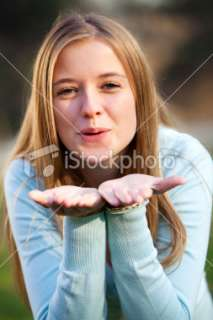 Young pretty girl blowing kiss Royalty Free Stock Photo