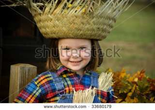 Cute Little Girl With Big Smile, In A Halloween Scarecrow Costume